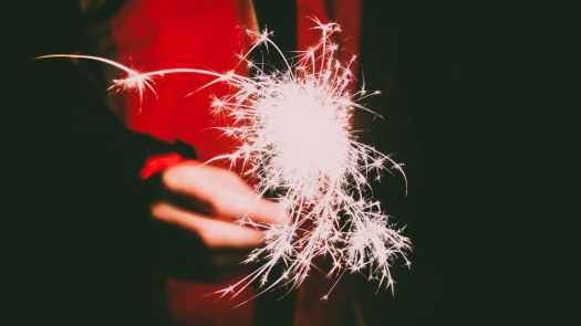photo of a person s hand holding firecracker