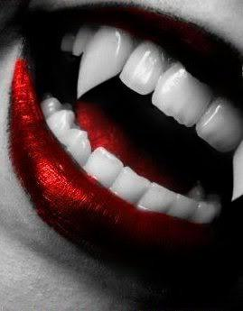 vampire fangs, metallic red lipstick